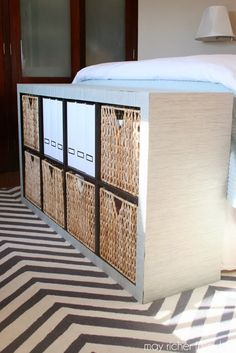 bookcase turned storage unit at the foot of the bed