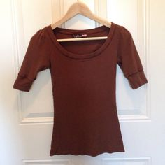 USA made 3/4 length sleeve tee Cute 100% cotton, made in the USA, three-quarter length sleeve tee. Brown with an eyelet-like pattern and cute detail at the shoulders. In very good used condition. Xs/xxs Tops Tees - Short Sleeve
