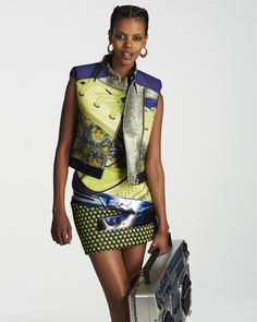 You're taking it to the streets, in Mary Katrantzou and flats—no heels.Grace Mahary in a Mary Katrantzou vest and dress, R.J. Graziano earringsMary Katrantzou sleeveless vest, $3,575; dress, price upon requestFor information: barneys.comR.J. Graziano gold doorknocker hoop earrings, $45For information: rjgraziano.com