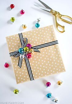 Creative Bows For Packages - Ribbon Bow With Ornament - Make DIY Bows for Christmas Presents and Holiday Gifts - Cute and Easy Ideas for Making Your Own Bows and Ribbons - Step by Step Tutorials and Instructions for Tying A Bow - Cheap and Crafty Gift Wrapping Ideas on A Budget http://diyjoy.com/diy-bows-gifts-packages #giftpackaging #holidaygiftswrapping