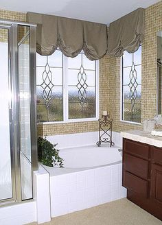 I love these for the bathroom with frosted glass. Elegant way to dress up a room!