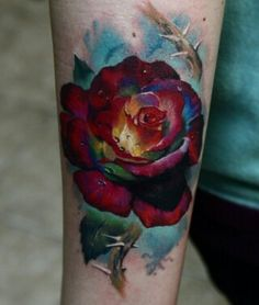 fifties style technicolor rose on lower inner arm