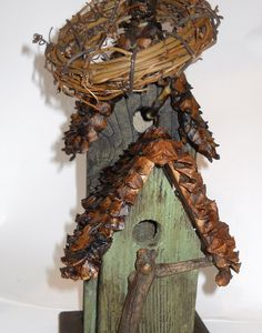 birdhouse with pine cone roof