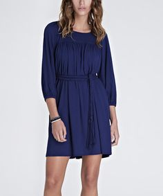 This solid piece showcases luxe European styling with top-notch construction and a no-frills look. The sleek dress flatters all figures with its waist-cinching silhouette, while the perfect blend of softness and stretch creates undeniable comfort. Size note: This item runs in UK sizes. Please refer to the size chart.