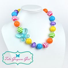 Colorful rainbow chunky gumball necklace for girls, features butterfly pendant.