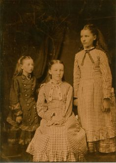 1800's Photo of Mary and Laura Ingalls Wilder in their prairie dresses with side pocket hankies
