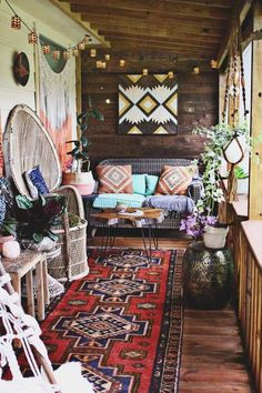 tiny boho porch decorated with rich colors and pastel hues