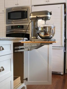A mixer or other heavy kitchen appliance can be lifted with ease to countertop level for use than conveniently stored in its own cabinet with out straining your back. Accessories can them be easily stored in the roll out shelf below. - Appliance Cabinet by Dura Supreme Cabinetry