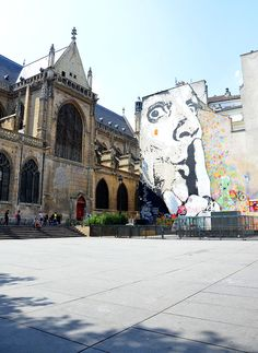 """This mural by Jeff 'Aerosol' (real name: Jean-Francois Perroy) in the Place Igor Stravinsky, titled """"Chuuuttt!"""" (Ssshhh!) is a self portrait that is not as it seems at first sight, an admonition to be silent, but his way of urging  people to stop and look around, to admire the beauty of a historic city, """"to listen to the soundtrack of the urban world"""" that according to him is so much more than the sound of cars and police sirens!"""