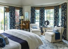 In the master bedroom, the clients' own club chairs wear new upholstery in a Dedar fabric.