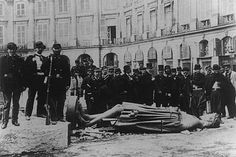 Communards pose with the statue of Napoléon I from the toppled Vendôme column, 1871