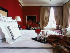 dark red, oxblood master bedroom walls