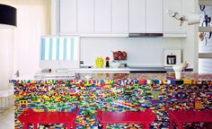 If you've somehow decided that a Lego kitchen island would look awesome in your home, here's something you should know: It's best to get a basic and plain kitchen island and then cover it with Lego pieces. It will take about a week or so and you'll need around 20,000 pieces for an island of this size