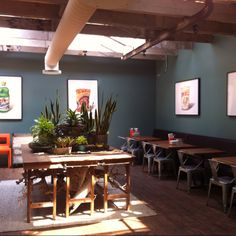 Industrial mid-century modern decor in The Mission SFO... Teal walls, tolix chairs, warm wood and orange accents.