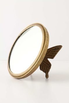 Behind the butterfly shaped table mirror