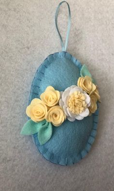 A hand cut hand sewed felt Easter egg ornament READY TO SHIP ornament perfect for Easter decor, Easter trees, Spring decor, Easter basket stuffer or gift. The listing is for 1 egg. The photos at the end show other styles available in the shop. The ornament measures approximately 3