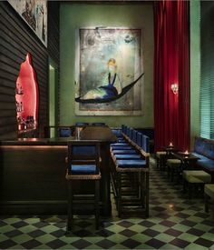 Those blue velvet bar stools in the Jar Bar look like the perfect place to enjoy a signature cocktail. Photo courtesy of Gramercy Park Hotel