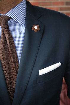 Love the knit tie/gingham combo. The flower in the buttonhole is a nice touch too.