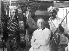 """Indonesia ~ Torajans posing with Dutch officer. The Toraja are an ethnic group indigenous to a mountainous region of South Sulawesi, Indonesia. Their population is approximately 1,100,000, of whom 450,000 live in the regency of Tana Toraja (""""Land of Toraja"""").[1] Most of the population is Christian, and others are Muslim or have local animist beliefs known as aluk (""""the way""""). The Indonesian government has recognized this animist belief as Aluk To Dolo (""""Way of the Ancestors"""")."""
