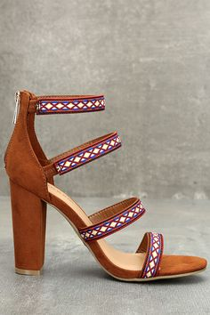 """An ultra glam silhouette is given the Boho treatment with the Mariko Chestnut Suede Embroidered Caged Heels! These luxe vegan suede heels have a cagey upper trimmed in blue, orange, yellow, and white embroidery. 3"""" heel zipper."""
