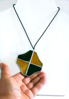 #glasspendant #freetobeunique #twofacespendant #doublefacenecklace #yellowandblack handmadeTiffany Amazing necklace in glass on one side and fabric on the other one. https://www.etsy.com/listing/237522433/yellow-and-black-double-face-necklace
