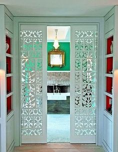 Cutout design pocket doors. Such a simple concept....why hasn't anyone thought of this before.  Or maybe I just haven't seen it, but I love it!!
