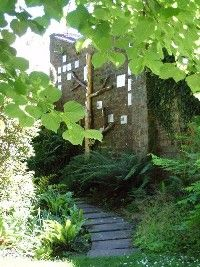 The Clan MacMillan Garden at the back of the Clan Centre is bounded by a large wall   upon which plaques in memory of clan ancestors are placed around a symbolic family tree.