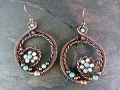 Hope Eternal  Copper Wire Wrapped Earrings - They are carefully oxidized and antiqued as thought passed down from generations. The tiny natural pearls and turquoise stones form a flower, gently cradled in a spiral cocoon.The copper beads are positioned at the points that support the eternal circle of life and represents the strength and love that is contained within the essence of all women.by SkyAndBeyond, $42.00