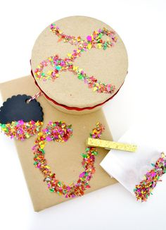 Use chipboard circles/squares to do confetti initials, and make ornaments out of them... make simple confetti gift wrap with Mod Podge