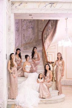 Staircases provide so much creative freedom when it comes to backdrops. This glamorous photo reminds us of a cast photo for a TV show.Related:25 Wedding-Planning Lessons From Our Favorite (and Least Favorite) On-Screen Couples