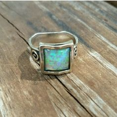 Opal Ring Size 8 sterling silver reconstructed opal ring. Hand made so looks like band isn't even but it is. Has beautiful sparkle. Jewelry Rings