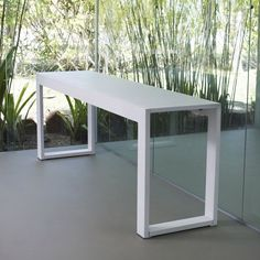 Hanover console features a unique natural wood veneer laminated over carbon steel frame. A painted glass top gives the Hanover a sleek surface top design.