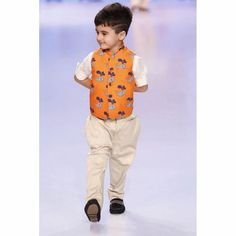 Stylemylo -- Take it from us, nothing makes a mother swoon faster than their kids dressed in a 'uniform' and jodhpuri pants paired with Nehru jackets just taps on that weakness. Baby Boy Dress, Baby Boy Outfits, Kids Outfits, Baby Dresses, Wedding Dresses, Kids Indian Wear, Kids Ethnic Wear, Little Boy Fashion, Kids Fashion Boy