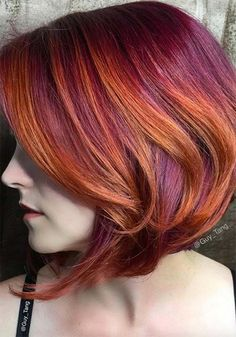 100 Badass Red Hair Colors: Auburn, Cherry, Copper, Burgundy Hair Shades Red hairstyles don't always require red dye – this combination of burnt orange and warm purple dye come together to create a subtle, flattering effect that seems natural, despite both colors being thoroughly unusual. Also worth noting is a beautiful example of balayage on slanted, bobbed hair.