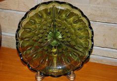Such a beautiful pattern and color to serve your olives and pickles.  Avocado Green Pressed Glass Relish Dish by TwinsTreasureTrove, $10.00