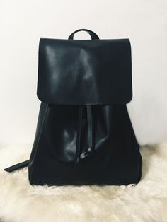 *Koda Bucket Backpack* (Black)  Dimension H: 15 (inches) W: 6.5 (inches) D: 6.5 (inches)  ▲Made with high quality vegan/faux Leather ▲Adjustable shoulder