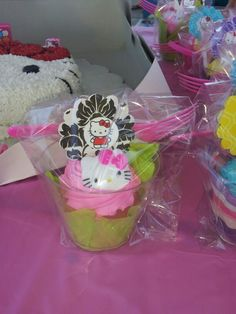 Take home cup cakes instead of party bag...Sams club cupcakes, diy cup cake topper. hello kitty theme. Turned out great!