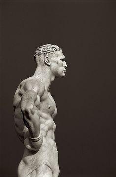 Marble Statue of an Athlete.Stadio dei Marmi - The Stadium of Marbles. Rome, Italy.