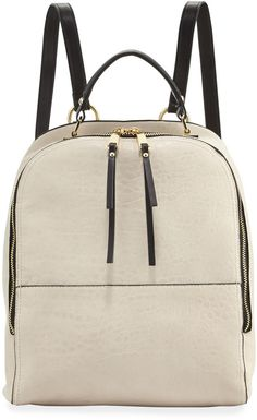 A two-tone backpack will work with any outfit.