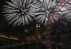 Fireworks explode across the London skyline near the London Eye during New Year celebrations in London. Jan. 1, 2014