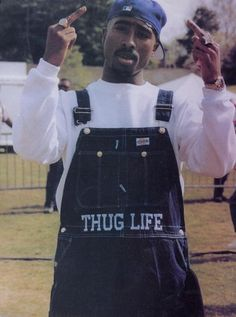 Tupac thugin' in some really badass overalls.