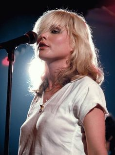 """Pictured here is Debbie Harry, better known as """"Blondie,"""" on stage back in The iconic new wave singer is also considered the first female rapper to chart at number one in the United States because of her work on Rapture. Blondie Debbie Harry, Debbie Harry Hot, Photo Rock, Man Photo, Photo Art, Musica Pop, Women Of Rock, New Wave, Female Singers"""