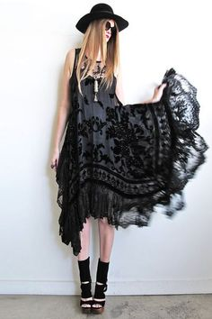 Thee most gorgeous little black dress ever! Stevie Nicks inspired loveliness using a hand beaded black velvet burnout shawl, embroidered mesh top bodice,scrumptious scalloped lace on hemline, finished off with beaded tassels! The bodice is cut tank style, very low on sides and is slightly sheer so you will need to wear a slip of sorts (shown with slip, not included). The skirt/dress portion is cut in a square for an amazing drape!