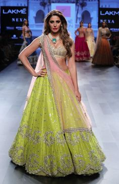 Shop yellow green with attractive sequins work & embroidery work lehenga choli online.This set is features a rust blouse in silk embroidery work.It has matching yellow green lehenga in satin silk with beautiful embroidery all over and pink dupatta in Half Saree Lehenga, Green Lehenga, Bridal Lehenga Choli, Silk Lehenga, Anarkali Gown, Lehenga Blouse, India Fashion Week, Lakme Fashion Week, Lehenga Designs