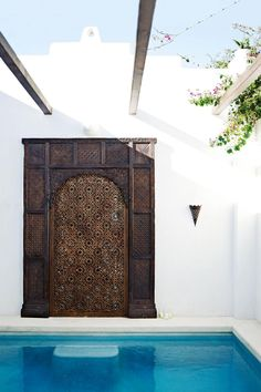 Modern-Moroccan-home-pool-2 | Adobe-inspired walls, ornate carving and timber beams from an old Sydney woodshed give this pool area its unique look.