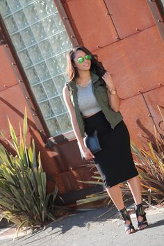 Grey crop top long black tight skirt olive green outer wear black heels