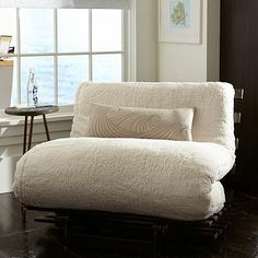 Sherpa Fleece Futon, this would be great for when someone is sleeping over because it turns into a bed