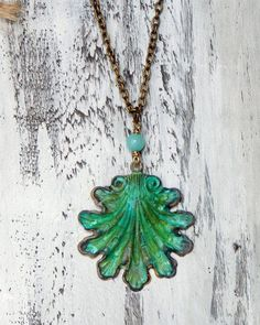 "This beautiful brass aqua green seashell has been hand patinaed and dangles below a aquamarine gemstone and antique brass chain..nickel and lead safe.  Measures 17""  Pendan... #beach_jewelry #beach_necklace #blue_green_necklace #blue_green_shelll #jewelry #nautical_jewelry #nautical_necklace #necklace #ocean_jewelry #patina_necklace #patina_shell #sea_shell_necklace #shell_jewelry #shell_necklace #vintage_style"