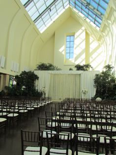 Set for an elegant wedding ceremony with rented chiavari chairs
