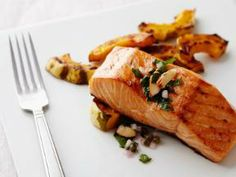 Get dinner on the table in just 20 minutes with a recipe for Oven-Baked Salmon from Food Network, and serve it with a Toasted Almond Parsley Salad. Oven Baked Salmon, Baked Salmon Recipes, Fish Recipes, Seafood Recipes, Paleo Recipes, Great Recipes, Dinner Recipes, Cooking Recipes, Favorite Recipes